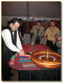Roulette dealer organizing his chips